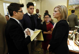 Photo - Eleazar Velazquez, Paul Gonzalez and Bessy Valles, undocumented college students, talk Thursday with Rep. Emily Virgin as they lobby against Senate Bill 423 at the state Capitol. Photos by Steve Sisney, The Oklahoman