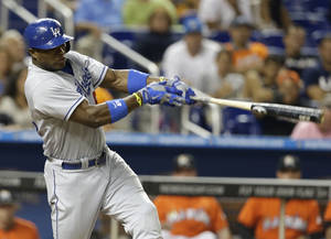 Photo - Los Angeles Dodgers' Yasiel Puig hits a solo home run in the eighth inning of a baseball game against the Miami Marlins, Tuesday, Aug. 20, 2013 in Miami. The Dodgers won 6-4. (AP Photo/Lynne Sladky)