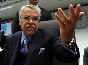 Photo - Saudi Arabia's Minister of Petroleum and Mineral Resources Ali Ibrahim Naimi gestures as he talks to journalists prior to the start of a meeting of the Organization of the Petroleum Exporting Countries, OPEC, at their headquarters in Vienna, Austria, Wednesday, Dec. 4, 2013. The OPEC ministers are meeting to decide on the cartel's oil output against a backdrop of slowing crude demand and unrest in member nation Libya. (AP Photo/Ronald Zak)