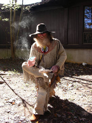 Photo - Right: An exhibitor shows off his woodburning techniques at a recent Beavers Bend Fall Festival. PHOTOs PROVIDED