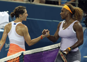 Photo - Serena Williams of the USA, right, shakes hands with Andrea Petkovic of Germany, left, after her 2nd round match  at the Brisbane International tennis tournament in Brisbane, Australia, Tuesday, Dec. 31, 2013. Williams won the match 6-6, 6-4. (AP Photo/Tertius Pickard)