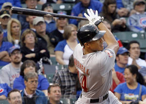 Photo -   Houston Astros' Justin Maxwell hits a three-run home run off Chicago Cubs relief pitcher Shawn Camp during the eighth inning of a baseball game, Wednesday, Oct. 3 2012, in Chicago. (AP Photo/Charles Rex Arbogast)