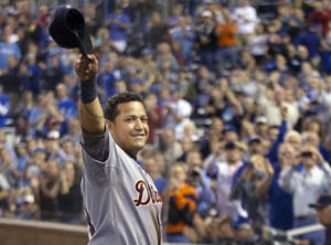 photo -   Detroit Tigers' Miguel Cabrera waves to the crowd after being replaced during the fourth inning of a baseball game against the Kansas City Royals at Kauffman Stadium in Kansas City, Mo., Wednesday, Oct. 3, 2012. Cabrera achieved baseball's first Triple Crown since 1967 by leading the league with a .330 average, 44 home runs and 139 RBIs in the regular season. (AP Photo/Orlin Wagner)