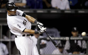photo -   Chicago White Sox's Alex Rios hits a three-run home run off Detroit Tigers starting pitcher Rick Porcello, also scoring Paul Konerko and Dewayne Wise, during the sixth inning of a baseball game, Monday, Sept. 10, 2012, in Chicago. (AP Photo/Charles Rex Arbogast)