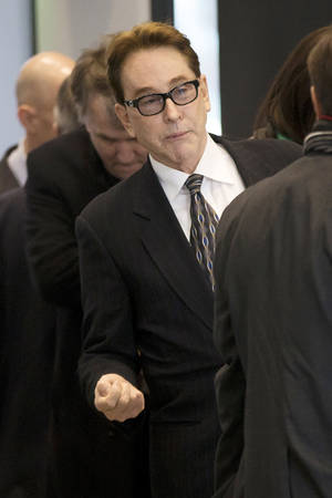 Photo - H. Ty Warner, the billionaire who created Beanie Babies, arrives at federal court for sentencing on Tuesday, Jan. 14, 2014, in Chicago. Last year Warner pleaded guilty to one count of tax evasion for hiding $25 million in income in secret Swiss bank accounts. (AP Photo/Andrew A. Nelles)
