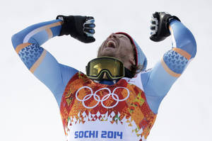 Photo - Norway's Kjetil Jansrud celebrates on the podium after winning the gold medal in the men's super-G at the Sochi 2014 Winter Olympics, Sunday, Feb. 16, 2014, in Krasnaya Polyana, Russia. (AP Photo/Charlie Riedel)