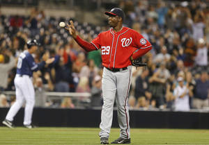 Photo - Washington Nationals closer Rafael Soriano snatches at a new ball after surrendering a game tying home run to San Diego Padres' Yonder Alonso during the bottom of the ninth inning of a baseball game Saturday June 7, 2014, in San Diego. (AP Photo/Lenny Ignelzi)