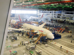 photo - FILE - In this April 27, 2012 photo, workers at Boeing's assembly plant in North Charleston, S.C. assemble a 787 jetliner. The company said Thursday that production continues normally at the plant despite the FAA grounding 787s now in service to check the safety of on board batteries.  (AP Photo/Bruce Smith, file)