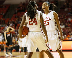 Photo - Oklahoma's Gioya Carter (25) and Sharane Campbell (24) celebrate late in the second half during a women's Bedlam college basketball game between the Oklahoma State University Cowgirls (OSU) and the University of Oklahoma Sooners (OU) at Lloyd Noble Center in Norman, Okla., Saturday, Feb. 1, 2014. OU won, 81-74. Photo by Nate Billings, The Oklahoman