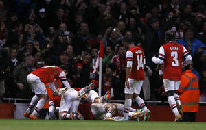 Photo - Arsenal players mob goalscorer Tomas Rosicky, as they celebrate, he scored his sides second gaolTottenham's  during the English FA Cup third round soccer match between Arsenal and Tottenham Hotspur at the Emirates Stadium in London, Saturday, Jan. 4, 2014. (AP Photo/Kirsty Wigglesworth)