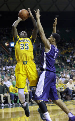 Photo - Baylor forward Taurean Prince (35) shoots against TCU center Karviar Shepherd (1) during the first half of an NCAA college basketball game Saturday, Jan. 11, 2014, in Waco, Texas. (AP Photo/LM Otero)