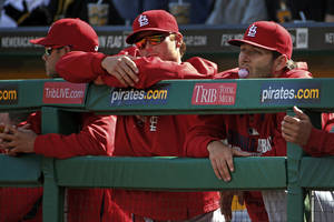 Photo - St. Louis Cardinals pitchers Lance Lynn, right, Shelby Miller, center, and Joe Kelly lean on the dugout railing during the ninth inning of a baseball game against the Pittsburgh Pirates in Pittsburgh Sunday, April 6, 2014. None of the three pitched in the 2-1 Pirates win. (AP Photo/Gene J. Puskar)