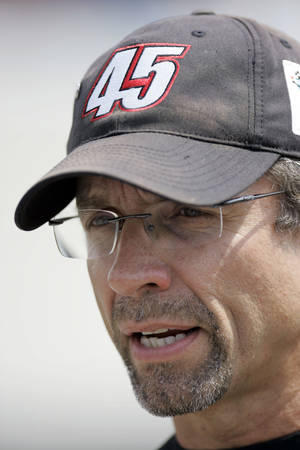 Photo - File- This May 1, 2007 file photo shows NASCAR driver Kyle Petty talking in the garage area before qualifiers for the Autism Speaks 400 auro race at Dover International Speedway in Dover, De. Petty, the driver-turned-analyst with the unfiltered opinions, has angered someone new. (AP Photo/Carolyn Kaster, File)