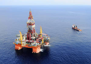 Photo - FILE - In this May 7, 2012 file photo released by China's Xinhua News Agency, Haiyang Shiyou oil rig 981, the first deep-water drilling rig developed in China, is pictured at 320 kilometers (200 miles) southeast of Hong Kong in the South China Sea. China on Wednesday, July 16, 2014 moved an oil rig that it had deployed in a section of the South China Sea, triggering a dispute with Vietnam. Beijing deployed the massive rig in early May close to the Paracel Islands, triggering a furious reaction in Hanoi and the most serious uptick in tensions in the waters in years. (AP Photo/Xinhua, Jin Liangkuai, File) NO SALES
