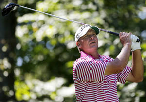 Photo -   Steve Stricker watches his shot from the ninth tee during the Pro Am round of the Deutsche Bank Championship golf tournament at TPC Boston in Norton, Mass., Thursday, Aug. 30, 2012. (AP Photo/Michael Dwyer)