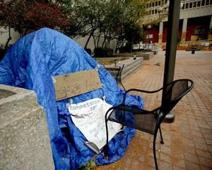 "Photo - A make-shift memorial for a man that was found dead Monday is shown at Kerr Park in Oklahoma City. Affectionately called ""The Poet,"" the man has still not been identified by officials and his cause of death has not been determined. <strong>BRYAN TERRY - THE OKLAHOMAN</strong>"