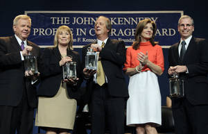 Photo -   Caroline Kennedy, second from right, applauds as the recipients of the 2012 John F. Kennedy Profile in Courage Awards hold their lanterns at the JFK Library in Boston, Monday, May 7, 2012. From left are Michael Streit, former Iowa Supreme Court Justice; Marsha Ternus, former Iowa Supreme Court Chief Justice; David Baker, former Iowa Supreme Court Justice; and Robert Ford, U.S. Ambassador to Syria. (AP Photo/Elise Amendola)