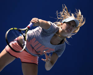Photo - Eugenie Bouchard of Canada practices serving during a training session at the Australian Open tennis championship in Melbourne, Australia, Wednesday, Jan. 22, 2014.  Bouchard will face Li Na of China in the women's singles semifinal Thursday.(AP Photo/Aijaz Rahi)