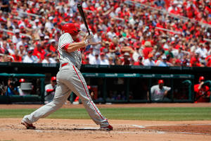 Photo - Philadelphia Phillies' Cody Asche hits a three-run double during the second inning of a baseball game against the St. Louis Cardinals, Sunday, June 22, 2014, in St. Louis. (AP Photo/Scott Kane)