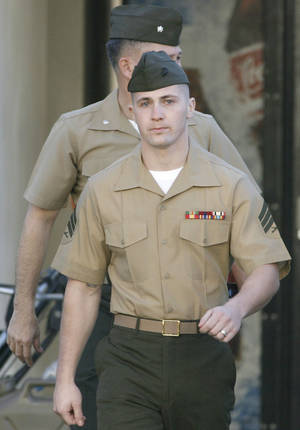 Photo -   FILE - In this Dec. 7, 2006, file photo, Marine Corps Sgt. Lawrence Hutchins III of Plymouth, Mass., arrives for his arraignment at Camp Pendleton Marine Corps Base, Calif. The military's highest court agreed Monday, July 2, 2012, to hear the appeal of Hutchins, who was convicted of murder in one of the most significant criminal cases against U.S. troops from the Iraq war.(AP Photo/Denis Poroy, File)