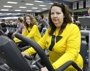 Photo - Christi Williams, right, and daughter Allyssa, 11, work out at the Earlywine YMCA. Christi is in the Livestrong program for cancer survivors. Photo By David McDaniel, The Oklahoman