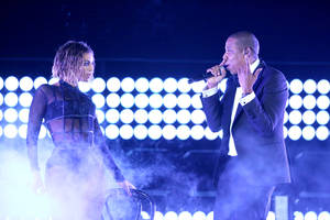 "Photo - FILE - This Jan. 26, 2014 file photo shows Beyonce, left, and Jay Z performing ""Drunk in Love"" at the 56th annual Grammy Awards in Los Angeles. Beyoncé and Jay Z lead in nominations for the BET Awards. The network announced Wednesday that the performers are both nominated for five awards, along with Drake. Pharrell and rising performer August Alsina have four nominations. The BET Awards will air live on June 29 from the Nokia Theatre L.A. Live. (Photo by Matt Sayles/Invision/AP, File)"