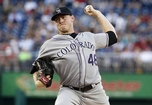 Photo - Colorado Rockies starting pitcher Tyler Matzek throws during the fourth inning of a baseball game against the Washington Nationals at Nationals Park, Wednesday, July 2, 2014, in Washington. (AP Photo/Alex Brandon)