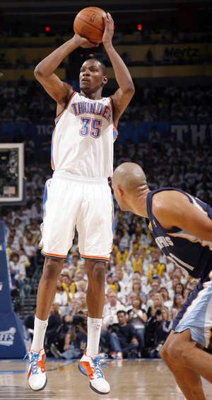 Photo - Oklahoma City's Kevin Durant (35) shoots as Shane Battier (31) of Memphis   watches during game five of the Western Conference semifinals between the Memphis Grizzlies and the Oklahoma City Thunder in the NBA basketball playoffs at Oklahoma City Arena in Oklahoma City, Wednesday, May 11, 2011. Photo by Sarah Phipps, The Oklahoman