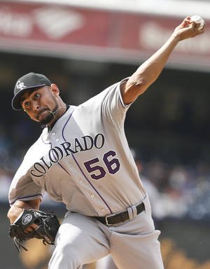 Photo - Colorado Rockies starting pitcher Franklin Morales works against the San Diego Padres during the first inning of a baseball game Thursday, April 17, 2014, in San Diego. (AP Photo/Lenny Ignelzi)