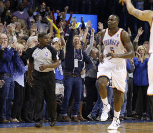 Photo - Oklahoma City's Kendrick Perkins (5) reacts after making a basket late in the fourth quarter of an NBA basketball game between the Oklahoma City Thunder and the Portland Trail Blazers at Chesapeake Energy Arena in Oklahoma City, Tuesday, Jan. 21, 2014. Oklahoma City won 105-97. PHOTO BY BRYAN TERRY, The Oklahoman