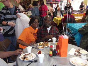 Photo - Shandra Abraham, left, and Nunnery Green, enjoy the food at the Soul Food Festival at Grace Living Center -- NE 21. (Photo provided)