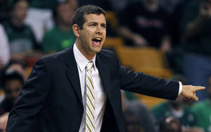 Photo - Boston Celtics coach Brad Stevens calls to his players during the first quarter of a preseason NBA basketball game against the Toronto Raptors, Monday, Oct. 7, 2013, in Boston. (AP Photo/Charles Krupa)