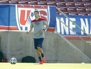 Photo - United States' Clarence Goodson, controls the ball during a training session on Wednesday, May 14, 2014, Stanford, Calif.  The US national soccer team kicked off its preparation camp at Stanford University preparing for the World Cup tournament, which gets underway in June. (AP Photo/Tony Avelar)