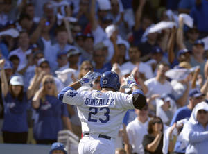 Photo - Los Angeles Dodgers' Adrian Gonzalez reacts after hitting a home run during the third inning of Game 5 of the National League baseball championship series against the St. Louis Cardinals Wednesday, Oct. 16, 2013, in Los Angeles. (AP Photo/Mark J. Terrill)