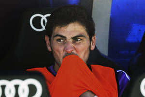 Photo - Real Madrid's goalkeeper Iker Casillas reacts during a Spanish La Liga soccer match against Betis at the Santiago Bernabeu stadium in Madrid, Spain, Sunday, Aug. 18, 2013. (AP Photo/Andres Kudacki)