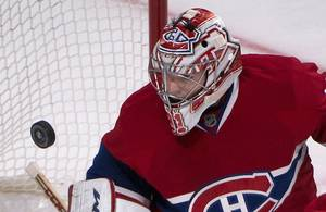 Photo - Montreal Canadiens goalie Carey Price watches the puck fly pass his net during the second period of an NHL hockey game, Thursday, Oct. 17, 2013 in Montreal. (AP Photo/The Canadian Press, Peter McCabe)