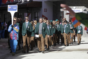 Photo - Members of the Australian Olympic team arrive for a welcome ceremony at the Mountain Olympic Village prior to the 2014 Winter Olympics, Thursday, Feb. 6, 2014, in Krasnaya Polyana, Russia. (AP Photo/Jae C. Hong)