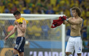 Photo - Brazil's David Luiz, right, applauds Colombia's James Rodriguez at the end of the World Cup quarterfinal soccer match between Brazil and Colombia at the Arena Castelao in Fortaleza, Brazil, Friday, July 4, 2014. Brazil won the match 2-1. (AP Photo/Manu Fernandez)