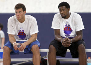 Photo - Los Angeles Clippers Blake Griffin talks with teammate DeAndre Jordan during his basketball camp held at the Santa Fe Family Life Center on Wednesday, Aug. 2, 2011, in Oklahoma City, Okla. Photo by Chris Landsberger, The Oklahoman