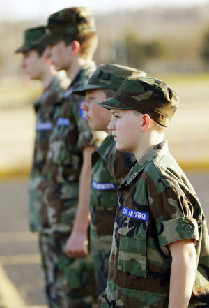 Photo - Cadets, including Brendan Schulte, foreground, stand in formation at a squadron meeting in Edmond.