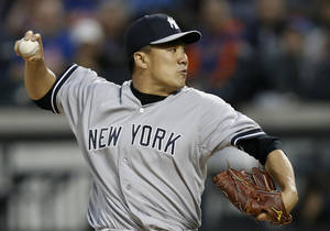 Photo - New York Yankees starting pitcher Masahiro Tanaka (19) delivers in the first inning against the New York Mets in a baseball game in New York, Wednesday, May 14, 2014. (AP Photo/)