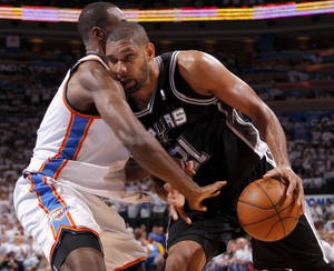 Photo - San Antonio's Tim Duncan (21) tries to get past Serge Ibaka (9) during Game 6 of the Western Conference Finals between the Oklahoma City Thunder and the San Antonio Spurs in the NBA playoffs at the Chesapeake Energy Arena in Oklahoma City, Wednesday, June 6, 2012. Photo by Bryan Terry, The Oklahoman