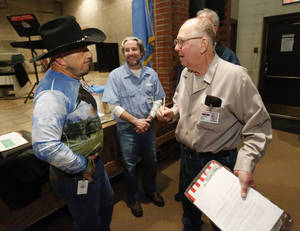 Photo - Veteran Ronald Pandos, left, talks with incarcerated veterans Travis Greer, center, and Eddie McCombs during the inaugural Battle Buddies meeting at James Crabtree Correctional Facility on Wednesday, Dec. 19, 2012 in Helena, Okla.  Photo by Steve Sisney, The Oklahoman