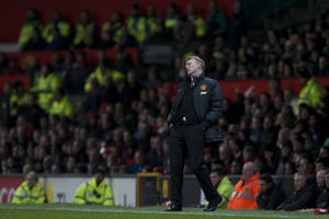 Photo - Manchester United's manager David Moyes watches as his team lose 2-1 to Swansea City in their English FA Cup third round soccer match at Old Trafford Stadium, Manchester, England, Sunday Jan. 5, 2014. (AP Photo/Jon Super)