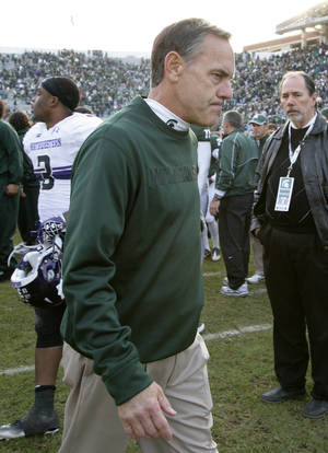 Photo -   Michigan State coach Mark Dantonio walks off the field following a 23-20 loss to Northwestern in an NCAA college football game, Saturday, Nov. 17, 2012, in East Lansing, Mich. (AP Photo/Al Goldis)