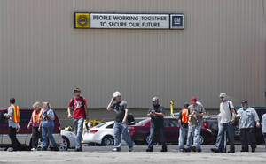 Photo - Employees evacuate the GM Marion Metal Center in Marion, Ind., following a chemical explosion Tuesday, July 1, 2014. One worker died and five more were taken to Marion General Hospital with non-life threatening injuries. (AP Photo/Chronicle-Tribune, Jeff Morehead)