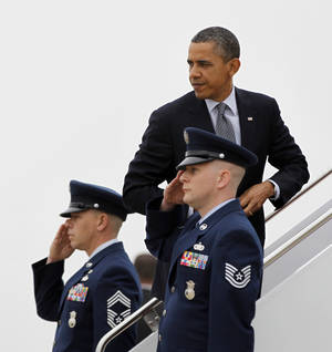 Photo -   President Barack Obama boards Air Force One before his departure from Andrews Air Force Base, Md., Friday, March, 16, 2012. Obama is traveling to Chicago and Atlanta for campaign fundraisers. (AP Photo/Pablo Martinez Monsivais)