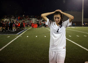 Photo - Edmond North's Madison Houghton walks of the field after losing to Bishop Kelley in girls 6A state championship soccer game in Newcastle, Okla., Friday, May 11, 2012. Photo by Bryan Terry, The Oklahoman