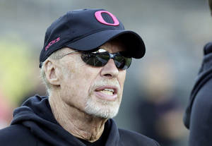 Photo - Nike founder and Oregon alumni Phil Knight sports a pink Oregon hat on the sidelines before an NCAA college football game against Washington State in Eugene, Ore., Saturday, Oct. 19, 2013. (AP Photo/Don Ryan)