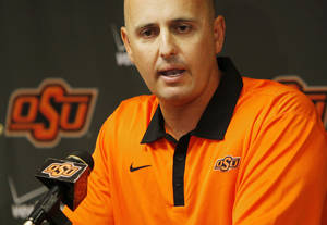 Photo - Josh Holliday speaks during a press conference at Oklahoma State University to introduce him as OSU's new head baseball coach, in Stillwater, Okla., Friday, June 8, 2012. Photo by Nate Billings, The Oklahoman